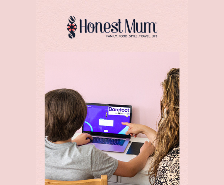 Honest mum, mother and child sat at computer